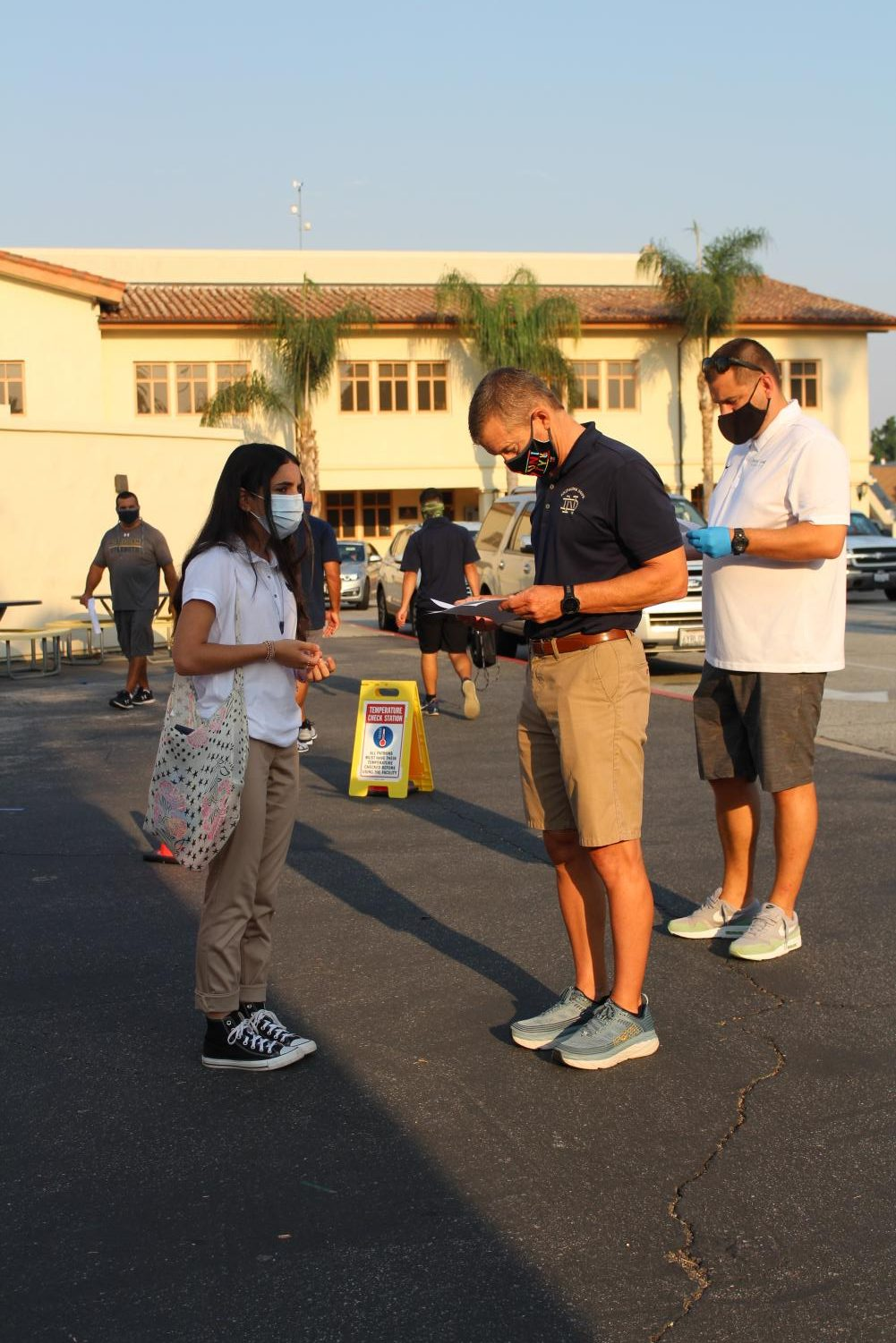 Everyone was required to do a health check in before entering classrooms to ensure safety for the day. Photo by: Mrs. Landinguin