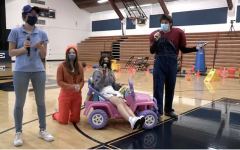 Seniors Isabella Ferrucci, Maddy Hicks, Madi Stein, and Ben Aguilera perform a skit for the rally.